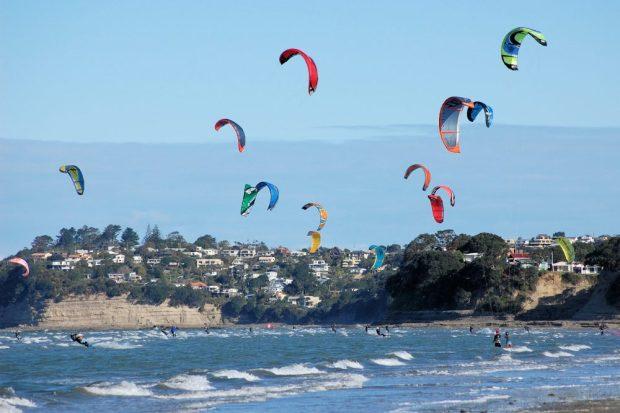 Image showing Orewa Beach with kitesurfers and coastal lifestyle